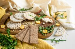 Round crispy rice crackers and Rye Crackers whith kumquat. Dietary concept and healthy vegetarian food. Round crispy rice crackers and Rye Crackers whith royalty free stock photos
