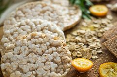 Round crispy rice crackers and Rye Crackers whith kumquat. Dietary concept and healthy vegetarian food. Round crispy rice crackers and Rye Crackers whith stock image