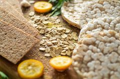 Round crispy rice crackers and Rye Crackers whith kumquat. Dietary concept and healthy vegetarian food. Round crispy rice crackers and Rye Crackers whith royalty free stock photography
