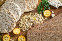 Round crispy rice crackers and Rye Crackers whith kumquat. Dietary concept and healthy vegetarian food. Round crispy rice crackers and Rye Crackers whith stock images