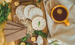 Round crispy rice crackers and Rye Crackers whith kumquat. Dietary concept and healthy vegetarian food. Round crispy rice crackers and Rye Crackers whith stock photos
