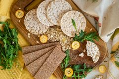 Round crispy rice crackers and Rye Crackers whith kumquat. Dietary concept and healthy vegetarian food. Round crispy rice crackers and Rye Crackers whith royalty free stock photo