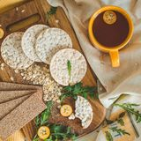 Round crispy rice crackers and Rye Crackers whith kumquat. Dietary concept and healthy vegetarian food. Round crispy rice crackers and Rye Crackers whith royalty free stock images