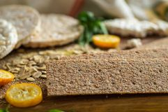 Round crispy rice crackers and Rye Crackers whith kumquat. Dietary concept and healthy vegetarian food. Round crispy rice crackers and Rye Crackers whith stock photo
