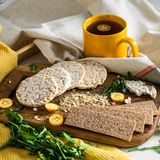 Round crispy rice crackers and Rye Crackers whith kumquat. Dietary concept and healthy vegetarian food. stock images