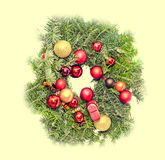 Round crown Christmas pine tree with globe ornaments close up Stock Image