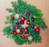 Round crown Christmas pine tree with globe ornaments close up Royalty Free Stock Photography