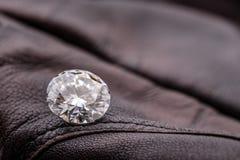 Diamond. Round cut diamond. Big carat diamond in leather royalty free stock photos