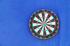 Round dartboard with numbers and with javelins Stock Photos