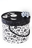 Round decorated luxury gift box. Round black and white gift box with floral decor vector illustration