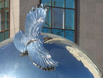 Round decoration. Astana, some interesting decoration in the residential quarter; flying bird on the round circle stock images
