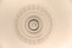 Round decorative plaster stucco relief molding with floral ornaments on white ceiling Stock Photos