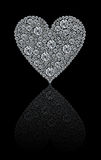 Round diamonds heart. A beautiful heart made by round white diamonds isolated on a black background with shadow Royalty Free Stock Photos