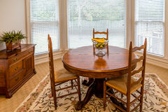 Round Dining Table in a Sunny Room stock photography