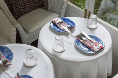 Round dining table and tableware Stock Photo