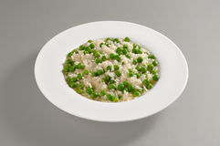 Round dish with boiled rice and peas Royalty Free Stock Photography