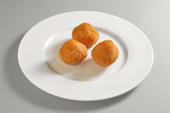 Round dish with fried breaded rice balls Royalty Free Stock Photo