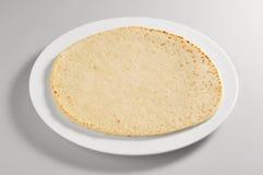 Round dish with piadina bread stock photos