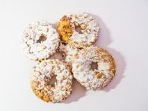 Round donut type cookies with hazelnut on white background. royalty free stock photography
