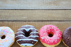 Round donuts with colored glaze Royalty Free Stock Photos