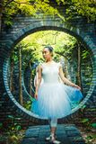 Round Door, Girl in Dance Skirt. Asian Chinese Red Brick Art Museum, outdoor circular doors, girls in dance skirts stock images