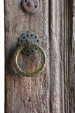 Round door handle with an arabic inscription, the old wooden doo Stock Photo