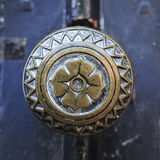 Round door handle. Closeup on ornate round metal door handle. Toulouse, France Stock Photos