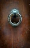 Round door knocker. Old round door knocker on wooden door royalty free stock photography