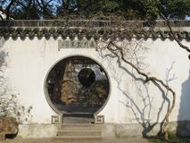 The round door and white wall of the Suzhou garden. royalty free stock photos