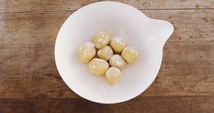 Round dough balls kept in a bowl 4k