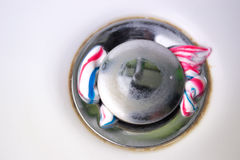 Round drain hole in white sink with toothpaste Stock Photos