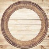 Round drewniana rama na drewnianym tle Obrazy Royalty Free