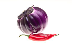 Round Eggplant And Chili Pepper Royalty Free Stock Photography