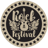 Round emblem with the guitar for a rock festival. Vector round emblem for Rock Festival with an electric guitar, wings and fire Stock Photos