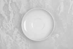 Round empty plate in the center of the old table Stock Photos