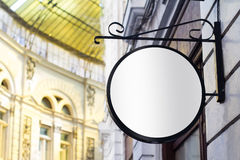 Round empty signboard on a building with classical architecture Royalty Free Stock Images