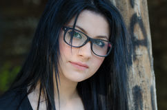 Round face lady with glasses and black clothes Stock Photography