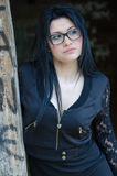 Round face lady with glasses and black clothes Stock Images