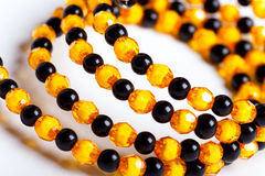 Round facet beads. Yellow and black facet beads royalty free stock image