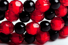Round facet beads. Red and black facet beads stock image