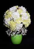 Round festive bouquet of yellow carnations Stock Images