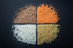 A round figure of dietary and vegetarian cereals: lentils, rice, bulgur and buckwheat.  royalty free stock photography
