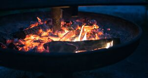 Round Fire Pit With Burning Wood Royalty Free Stock Photo