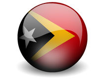 Round Flag of Timor-Leste. With Glossy Effect Stock Photos