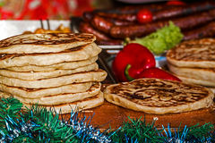 Round flat bread cooked on the grill Royalty Free Stock Images