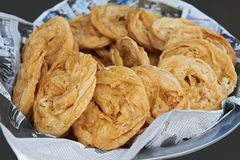 Round flat crispy pastries at an street eatery in Thailand stock image