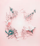 Round floral frame arrangement with pastel pink flowers, top view stock photos