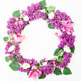 Round floral frame of lilac branches and tulips on white background. Flat lay, top view. Summer pattern Stock Images