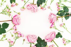 Round floral frame made of pink roses on white background. Flat lay, Top view. Valentines day composition stock image