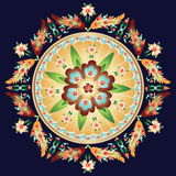 Round Floral Medallion. Round motif of flowers in autumn colors and leaves on dark blue Stock Image
